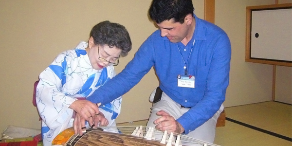 Sharing in culture playing the koto